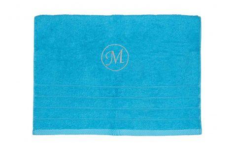 Πετσέτα τυρκουάζ με κεντημένο μονόγραμμα